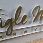 Szyld reklamowy Figle Migle